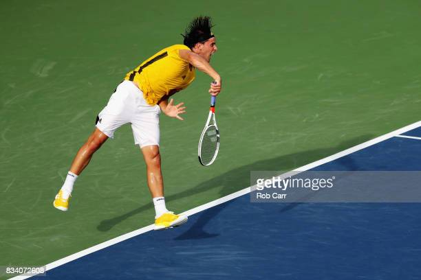 of Dominic Thiem of Austria serves to Adrian Mannarino of France during Day 6 of the Western and Southern Open at the Linder Family Tennis Center on...