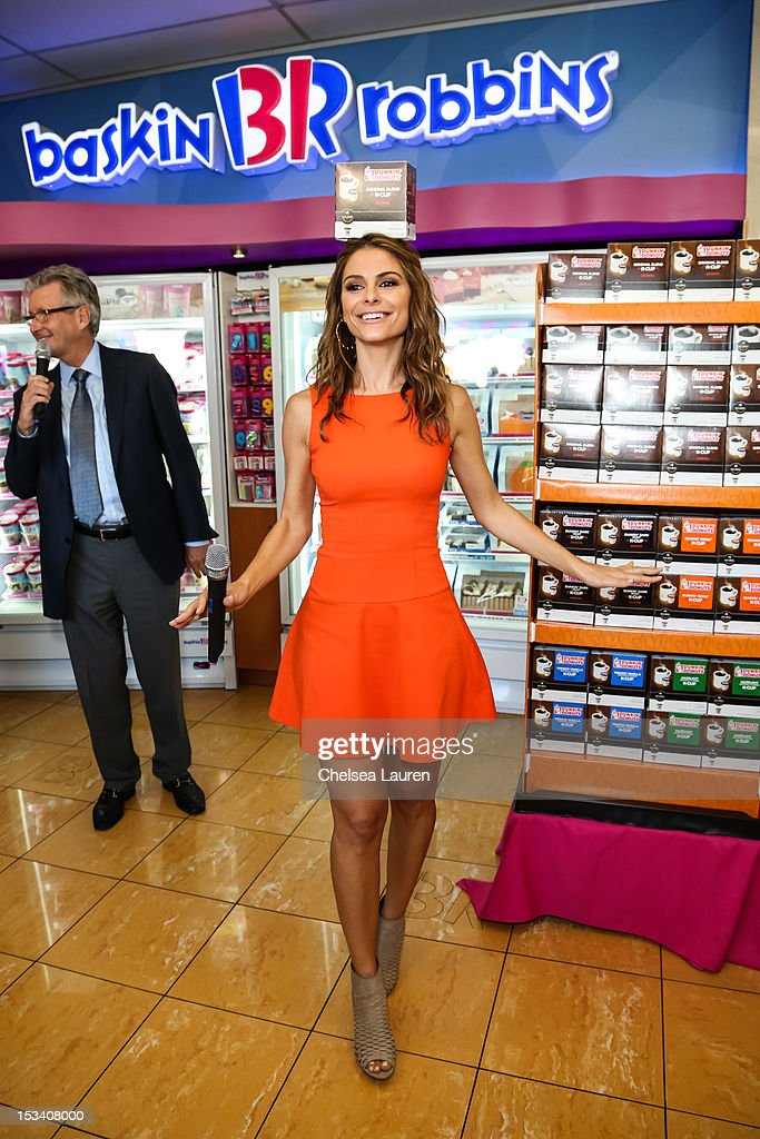 CEO of Dunkin' brands / president of Dunkin' Donuts Nigel Travis (L) and actress Maria Menounos attend the launch of Dunkin' Donuts K-Cups at Baskin-Robbins on October 4, 2012 in Burbank, California.