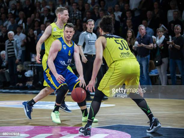 KRAMER of EWE Baskets Oldenburg and Assem Marei of medi bayreuth battle for the ball during the easyCredit BBL match between medi bayreuth and EWE...