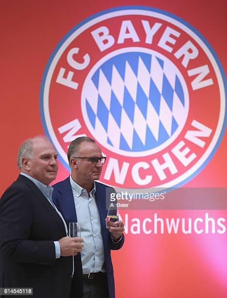 CEO of FC Bayern Muenchen KarlHeinz Rummenigge and former president Uli Hoeness are pictured during a party to thank the workers of the construction...