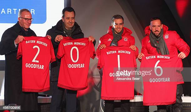 CEO of FC Bayern Muenchen KarlHeinz Rummenigge CEO of Goodyear Dunlop Tires Germany Juergen Titz Philipp Lahm and Franck Ribery of FC Bayern Muenchen...