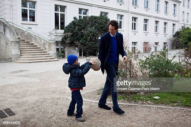 CEO of Fiat Chrysler Automobiles John Elkanni is photographed for Paris Match in Paris with his son Leone visiting his former high school Lycee...