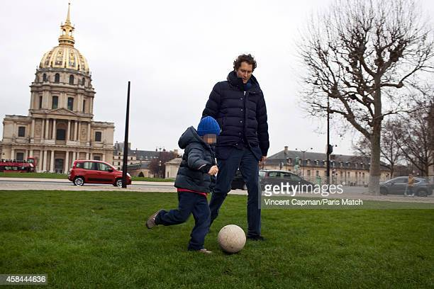 CEO of Fiat Chrysler Automobiles John Elkanni is photographed for Paris Match in Paris with his son Leone on March 11 2012