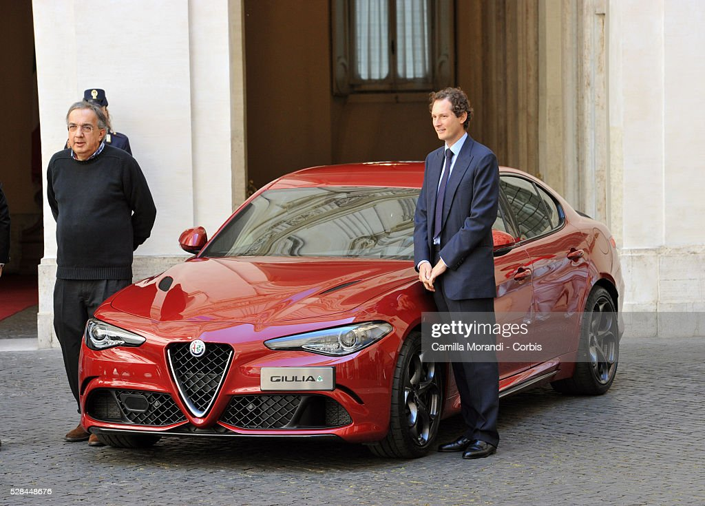 CEO of Fiat Chrysler Automobiles <a gi-track='captionPersonalityLinkClicked' href=/galleries/search?phrase=Sergio+Marchionne&family=editorial&specificpeople=608333 ng-click='$event.stopPropagation()'>Sergio Marchionne</a> and Chairman of Fiat Chrysler Automobiles <a gi-track='captionPersonalityLinkClicked' href=/galleries/search?phrase=John+Elkann&family=editorial&specificpeople=571803 ng-click='$event.stopPropagation()'>John Elkann</a> attend the unveiling of Italian car manufacturer Alfa Romeo's latest car The Alfa Romeo Giulia on May 5, 2016 in Rome, Italy.
