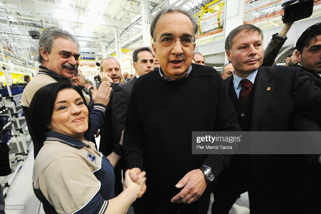 CEO of FIAT group <a gi-track='captionPersonalityLinkClicked' href=/galleries/search?phrase=Sergio+Marchionne&family=editorial&specificpeople=608333 ng-click='$event.stopPropagation()'>Sergio Marchionne</a> greets workers during the unveiling of the new Maserati plant in Grugliasco, which has been dedicated to Gianni Agnelli on January 30, 2013 in Turin, Italy. The new plant near the company's headquarters in Turin will produce Maserati's new model of luxury saloon cars, the Quattroporte.