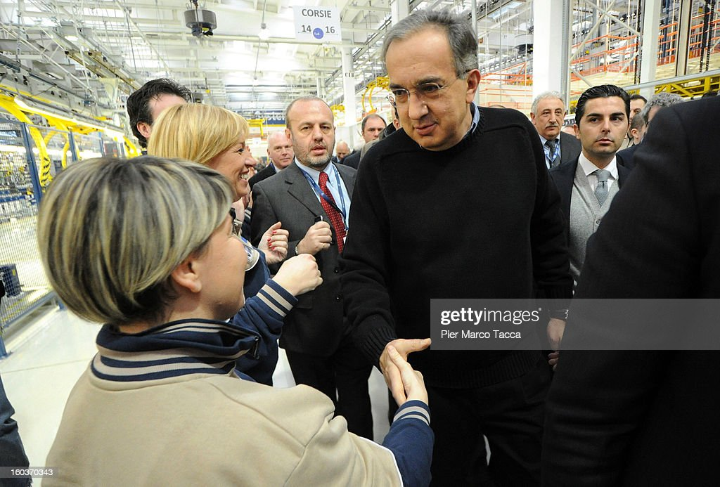 CEO of FIAT group Sergio Marchionne greets workers during the unveiling of the new Maserati plant in Grugliasco, which has been dedicated to Gianni Agnelli on January 30, 2013 in Turin, Italy. The new plant near the company's headquarters in Turin will produce Maserati's new model of luxury saloon cars, the Quattroporte.