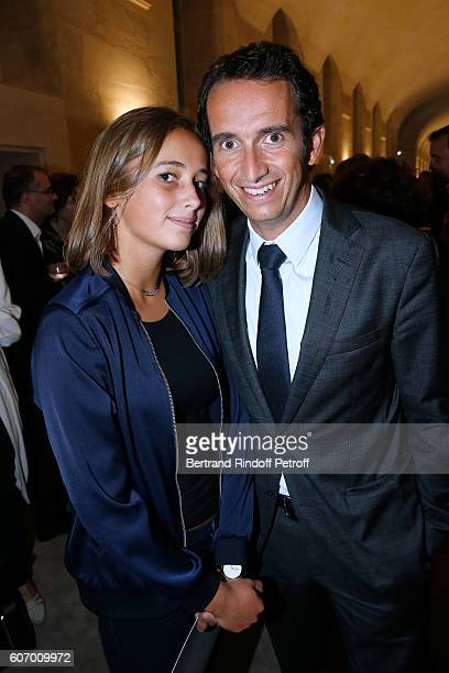 CEO of Fnac Alexandre Bompard and his daughter attend the 4O Rue de Sevres Preview at the Head Offices of Both Kering and Balenciaga building The...