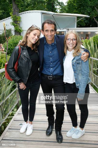CEO of Fnac Alexandre Bompard standing between his daughters Juliette and Romane attend the 2017 French Tennis Open Day Height at Roland Garros on...