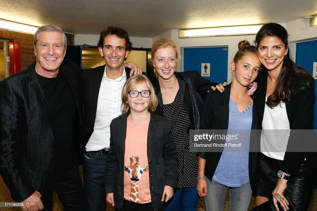 CEO of Fnac Alexandre Bompard (2nd L) with wife Charlotte (3rd R) with their children Roman and Juliette, Jean-Claude Darmon (L) with his companion Hoda Roche (R) attend the last concert in Paris of Patrick Bruel, held at Palais Omnisports de Bercy on June 22, 2013 in Paris, France.