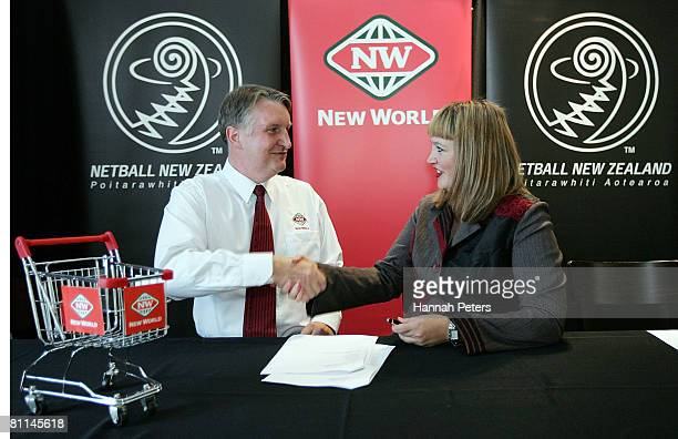 CEO of Foodstuffs South Island Steve Anderson shakes hands with New Zealand Netball CEO Raelene Castle after a Netball New Zealand press conference...