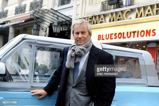 CEO of French industrial group Bollore Vincent Bollore poses as he arrives to hold a press conference on Autolib a French electric car pickup service...
