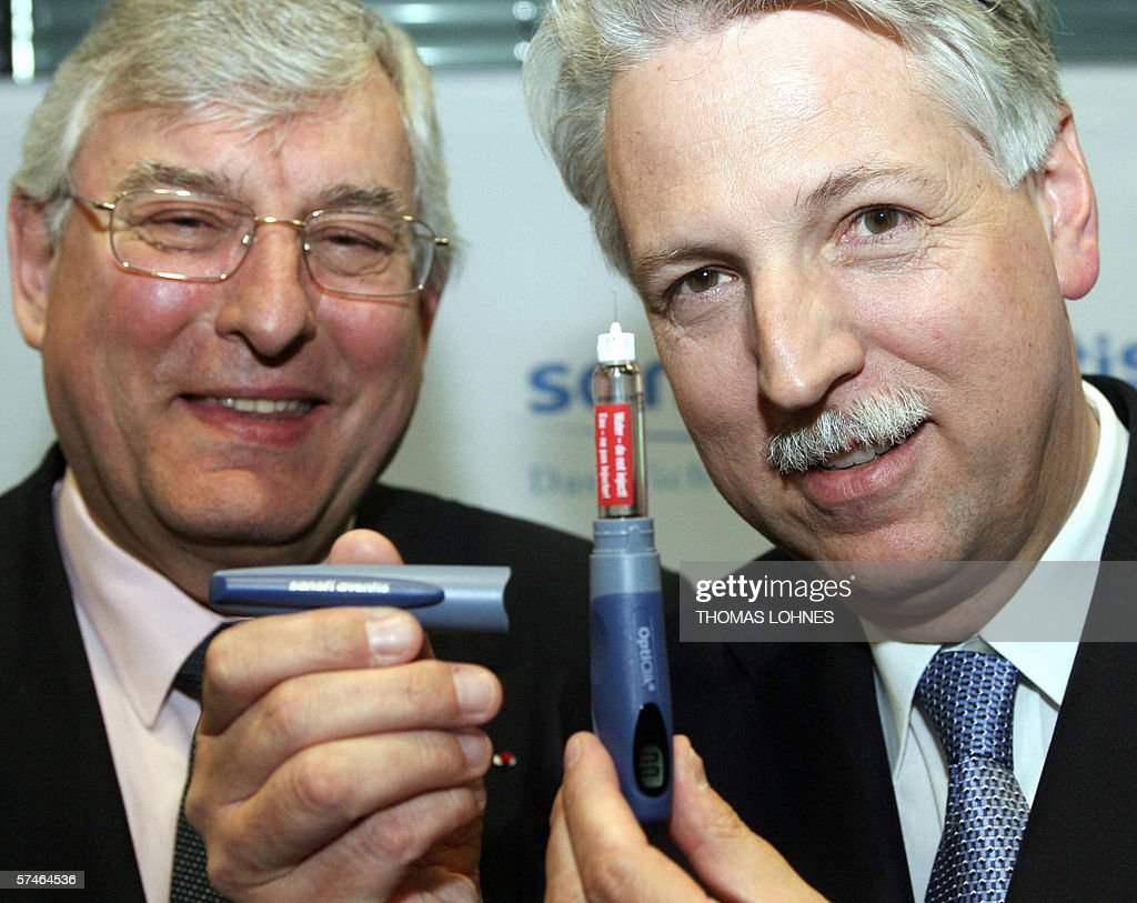 CEO of French pharmaceutical giant SanofiAventis JeanFrancois Dehecq and chief of German operations HeinzWerner Mueller pose with an Opticlick...