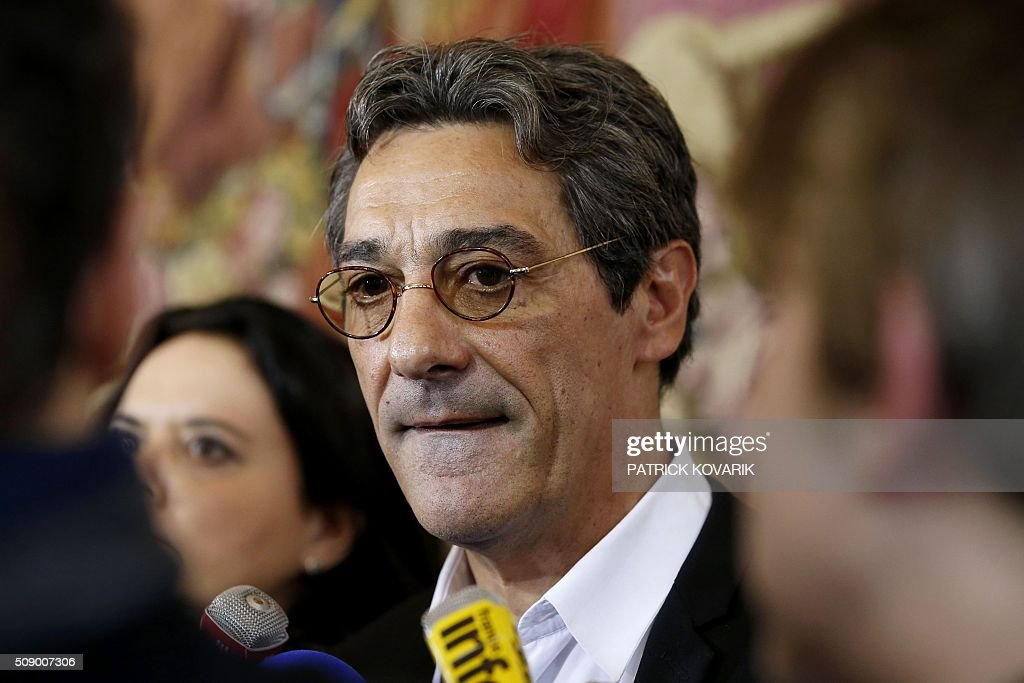 CEO of French retail and supermarket group Systeme U, Serge Papin, talks to journalists at the Hotel Matignon in Paris, on February 8, 2016, for a meeting with the French prime minister, agriculture minister and economy minister, amid a crisis in France's agricultural sector. French farmers have carried out a string of demonstrations for nearly two weeks against the falling prices of their products, demanding structural measures to strengthen price rates. / AFP / PATRICK KOVARIK