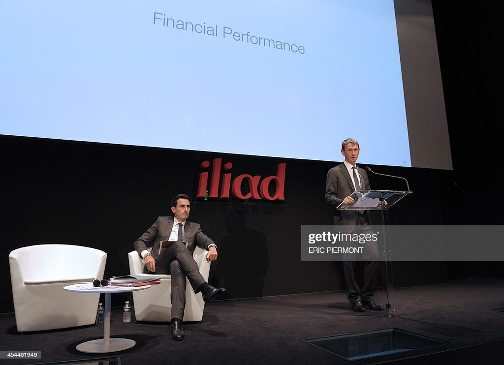 CEO of French telecom group Iliad Maxime Lombardini gives a press conference next to CFO Thomas Reynaud (L) to present the group's 2014 first half results, in Paris on September 1, 2014