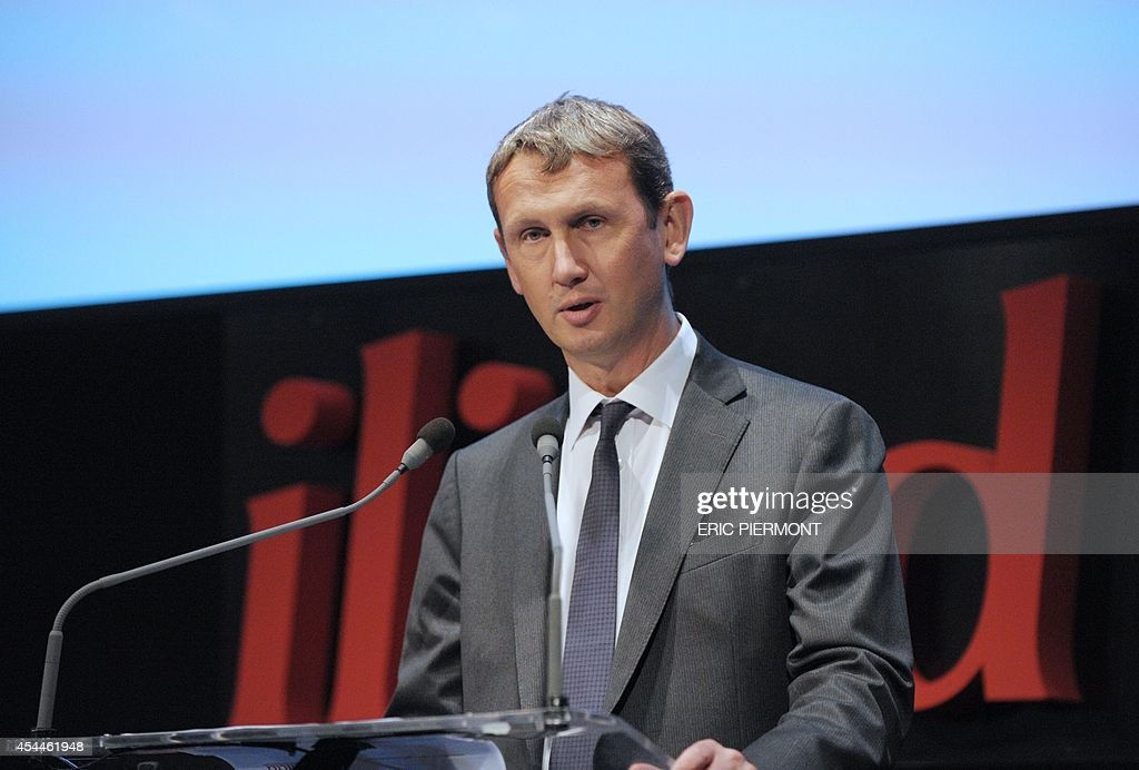 CEO of French telecom group Iliad Maxime Lombardini talks during a press conference to present the group's 2014 first half results, in Paris on September 1, 2014
