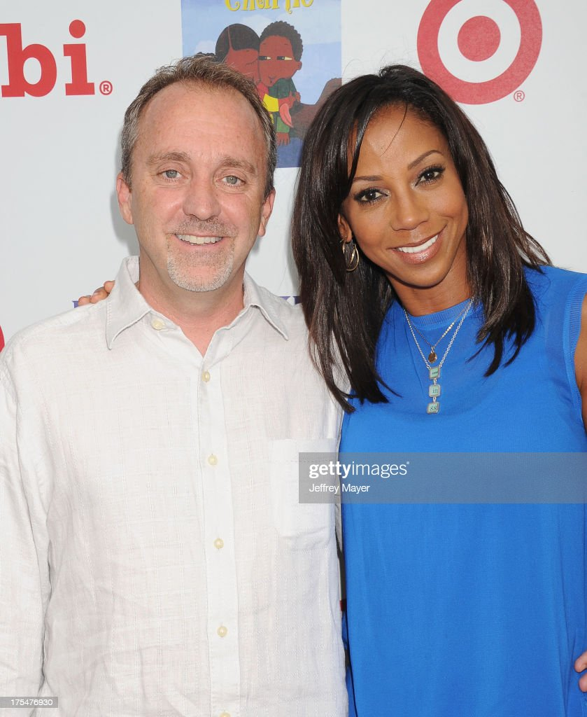 CEO of Fuhu, Inc. Jim Mitchell and actress <a gi-track='captionPersonalityLinkClicked' href=/galleries/search?phrase=Holly+Robinson+Peete&family=editorial&specificpeople=213716 ng-click='$event.stopPropagation()'>Holly Robinson Peete</a> arrive at HollyRod Foundation's 4th Annual 'My Brother Charlie' Carnival at Culver Studios on August 3, 2013 in Culver City, California.