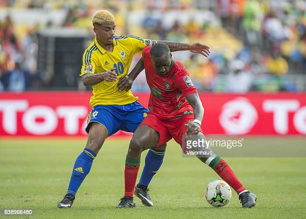 LEMINA of Gabon and NANISSIO MENDES SOARES of Guinea Bissau during the Group A match between Gabon v GuineaBissau at Stade de L'Amitie on January 14...