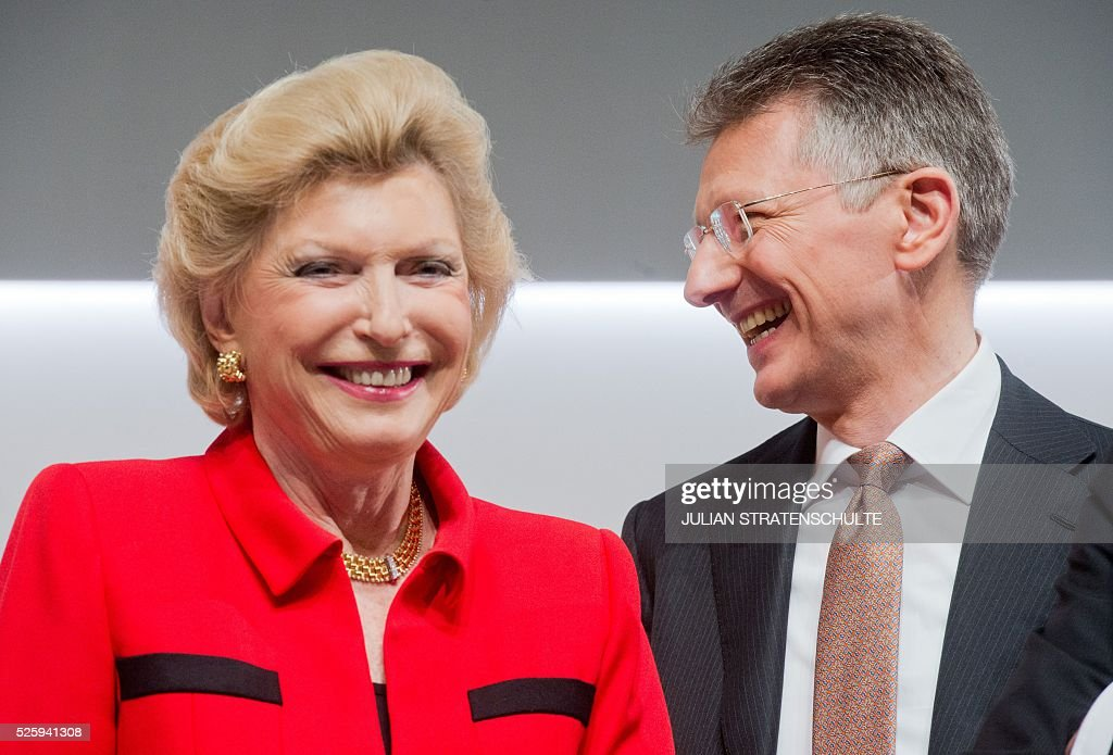 CEO of German car parts specialist Continental Elmar Degenhart (R) and member of board Maria-Elisabeth Schaeffler-Thumann attend the company's annual general meeting on April 29, 2016 in Hanover, northern Germany. Continental said it got off to a good start to the year, driven largely by strong demand for its tyres. / AFP / dpa / Julian Stratenschulte / Germany OUT