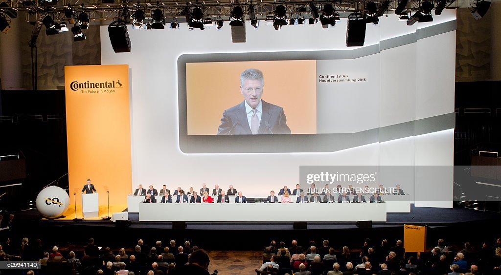 CEO of German car parts specialist Continental Elmar Degenhart speaks during the company's annual general meeting on April 29, 2016 in Hanover, northern Germany. Continental said it got off to a good start to the year, driven largely by strong demand for its tyres. / AFP / dpa / Julian Stratenschulte / Germany OUT