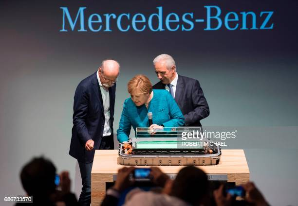 CEO of German carmaker Daimler and MercedesBenz Dieter Zetsche German Chancellor Angela Merkel and Saxony State Premier Stanislaw Tillich during the...