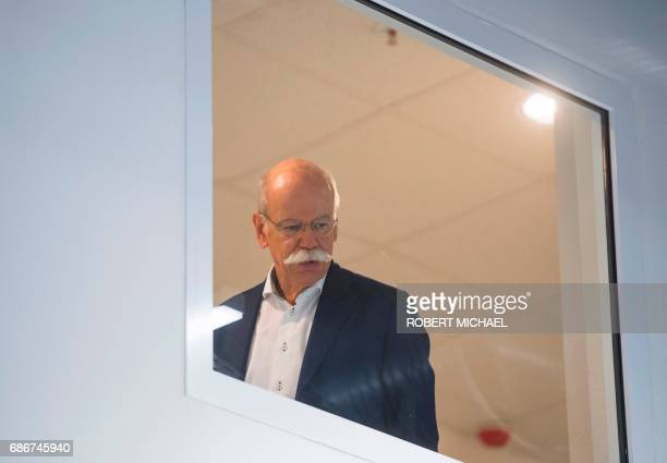 CEO of German carmaker Daimler and MercedesBenz Dieter Zetsche looks through a window prior to a visit to the new plant of the ACCUMOTIVE company...