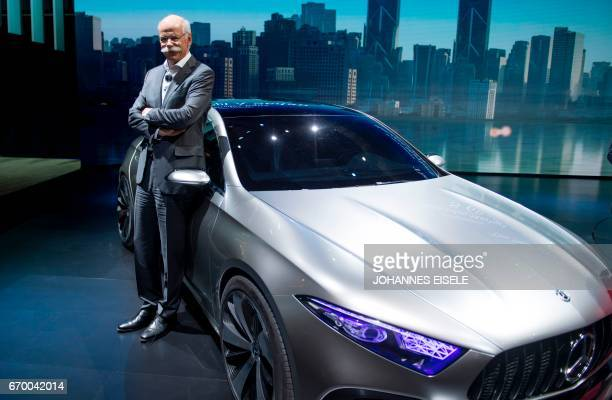CEO of German carmaker Daimler and MercedesBenz Dieter Zetsche poses next to a Concept Sedan A car during the media day of the 17th Shanghai...
