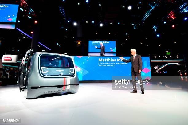 CEO of German carmaker Volkswagen Matthias Mueller present Sedric the group's first autonomous car prototype during a preview night for the media on...