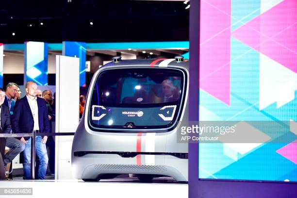 CEO of German carmaker Volkswagen Matthias Mueller presents Sedric the group's first autonomous car prototype during a preview night for the media on...