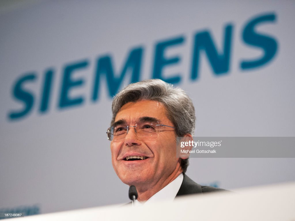 CEO of German engineering giant Siemens AG, Joe Kaeser laughs during Siemens annual press conference on November 7, 2013 in Berlin, Germany. German engineering giant Siemens said Thursday it expects to book a further increase in bottom-line earnings in 2014 after achieving its targets this year.