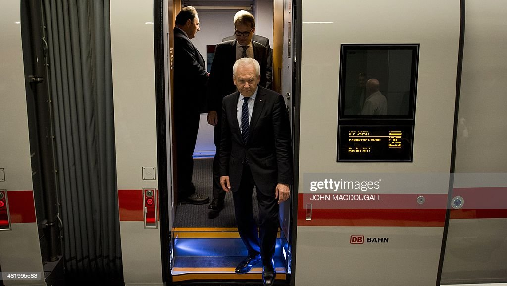 CEO of German railway giant Deutsche Bahn (DB) Ruediger Grube gets off a carriage of a Siemens InterCity Express (ICE) 3 train during a presentation of the last of 8 new ICE 3 trains recently delivered to DB, at Berlin's main railway station April 2, 2014.