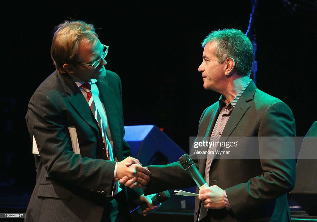 CEO of Global Green Matt Petersen (L) and GM Group Manager, Policy and Product Dave Barthmuss shake hands on stage during Global Green USA's 10th Annual Pre-Oscar Party at Avalon on February 20, 2013 in Hollywood, California.