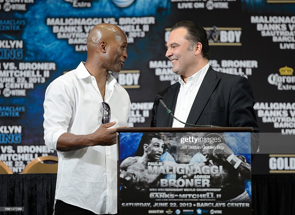 CEO of Golden Boy Promotions Richard Schaefer talks with boxer Bernard Hopkins on stage during the news conference discussing the upcoming fight between boxers Adrien Broner and Paulie Malignaggi before the Floyd Mayweather Jr. and Robert Guerrero fight at the MGM Grand Garden Arena on May 4, 2013 in Las Vegas, Nevada.