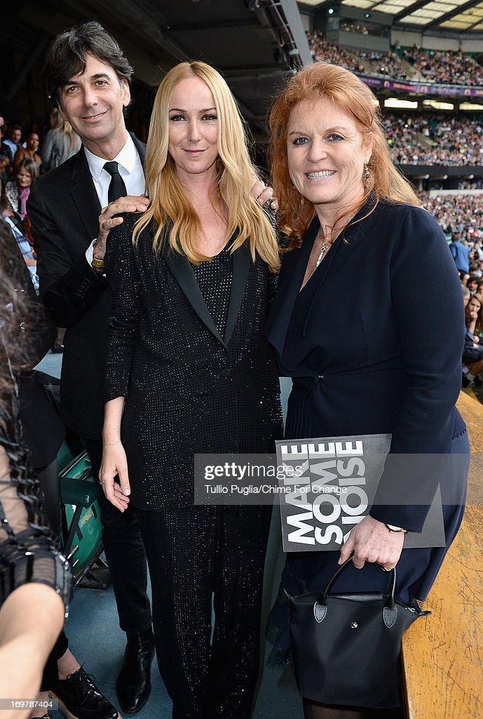 CEO of Gucci Patrizio di Marco, Creative Director of Gucci <a gi-track='captionPersonalityLinkClicked' href=/galleries/search?phrase=Frida+Giannini&family=editorial&specificpeople=559380 ng-click='$event.stopPropagation()'>Frida Giannini</a> and <a gi-track='captionPersonalityLinkClicked' href=/galleries/search?phrase=Sarah+Ferguson+-+Duchess+of+York&family=editorial&specificpeople=160596 ng-click='$event.stopPropagation()'>Sarah Ferguson</a> pose inside the Royal Box at the 'Chime For Change: The Sound Of Change Live' Concert at Twickenham Stadium on June 1, 2013 in London, England. Chime For Change is a global campaign for girls' and women's empowerment founded by Gucci with a founding committee comprised of Gucci Creative Director <a gi-track='captionPersonalityLinkClicked' href=/galleries/search?phrase=Frida+Giannini&family=editorial&specificpeople=559380 ng-click='$event.stopPropagation()'>Frida Giannini</a>, Salma Hayek Pinault and Beyonce Knowles-Carter.