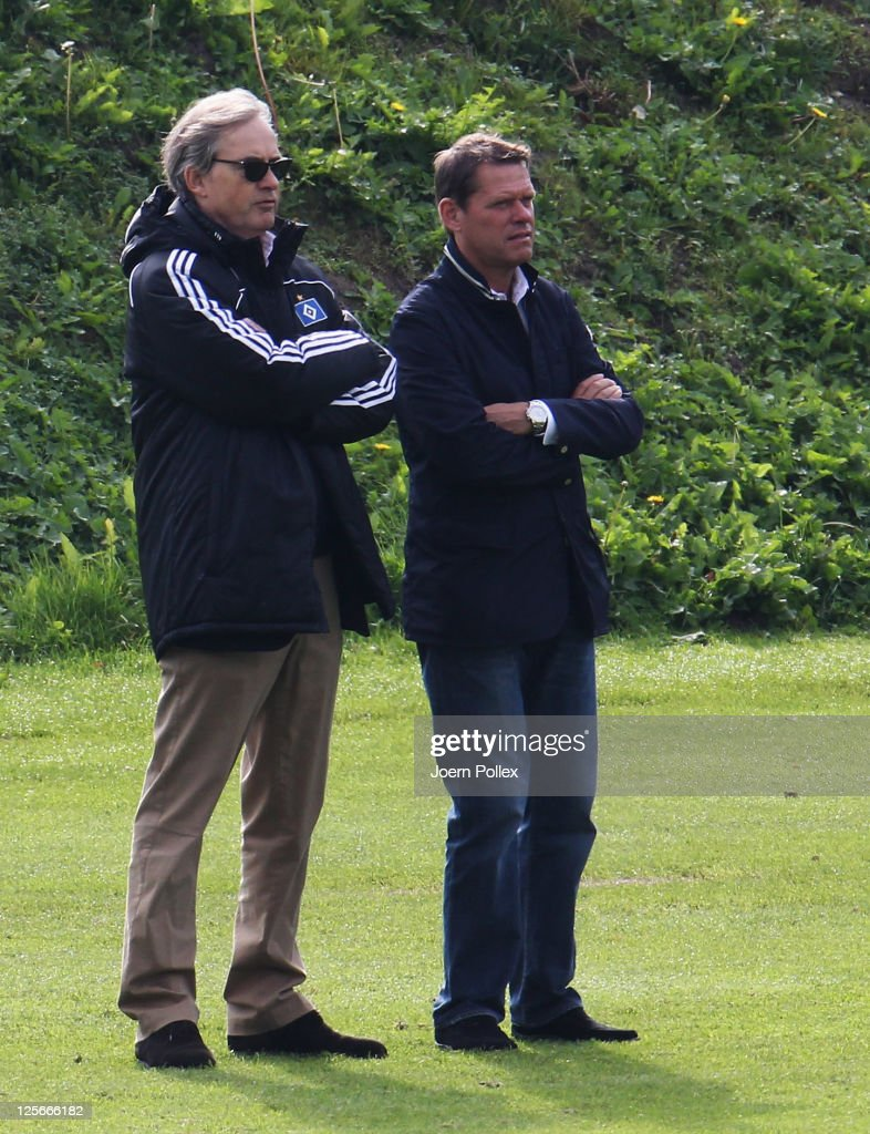 CEO of Hamburger SV CarlEdgar Jarchow and sport director Frank Arnesen are seen during a Hamburg SV training session on September 20 2011 in Hamburg...