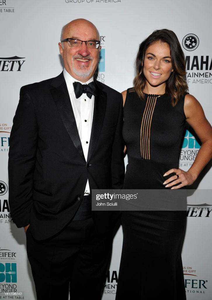 CEO of Heifer International Pierre Ferrari (L) and actress <a gi-track='captionPersonalityLinkClicked' href=/galleries/search?phrase=Serinda+Swan&family=editorial&specificpeople=4388541 ng-click='$event.stopPropagation()'>Serinda Swan</a> attend Heifer International's 2nd Annual 'Beyond Hunger: A Place at the Table' to Help End World Hunger and Poverty at Montage Hotel on September 19, 2013 in Los Angeles, California.