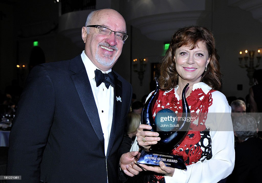 CEO of Heifer International Pierre Ferrari (L) and Honoree Susan Sarandon posing with the Noble Globe Award during Heifer International's 2nd Annual 'Beyond Hunger: A Place at the Table' to Help End World Hunger and Poverty at Montage Hotel on September 19, 2013 in Los Angeles, California.
