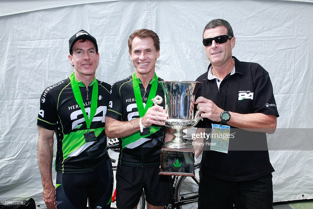 CEO of Herbalife Michael O. Johnson (R) and his team win first place at the LA Triathlon presented by Herbalife on September 25, 2011 in Los Angeles, California.