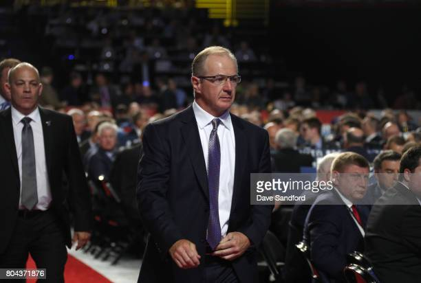 VP of hockey operations Al MacInnis walks to the podium during Round One of the 2017 NHL Draft at United Center on June 23 2017 in Chicago Illinois