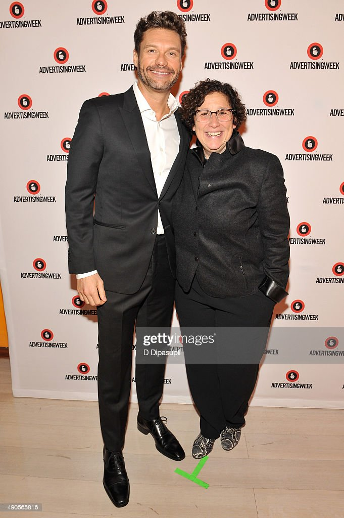 EVP & CMO of iHeartMedia Gayle Troberman and Ryan Seacrest pose at the Sound Strategy: Why Millennials and Gen Z Are Listening More panel presented by iHeartMedia during Advertising Week 2015 AWXII at the Times Center Stage on September 29, 2015 in New York City.