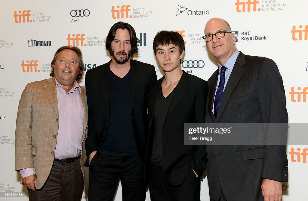CEO of IMAX Corp Richard L. Gelfond, actor <a gi-track='captionPersonalityLinkClicked' href=/galleries/search?phrase=Keanu+Reeves&family=editorial&specificpeople=171568 ng-click='$event.stopPropagation()'>Keanu Reeves</a>, actor Tiger Chen and CEO of IMAX Entertainment and Senior Executive Vice President, IMAX Corp Greg Foster arrive at the 'Metallica: Through The Never' Premiere during 2013 Toronto International Film Festival at Scotiabank Theatre on September 9, 2013 in Toronto, Canada.