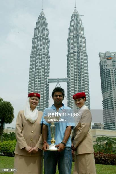 2 of India poses with Air Emirates girls with the ICC U19 Cricket World Cup at the Kuala Lumpur Twin Towers on March 3 2008 in Kuala Lumpur Malaysia