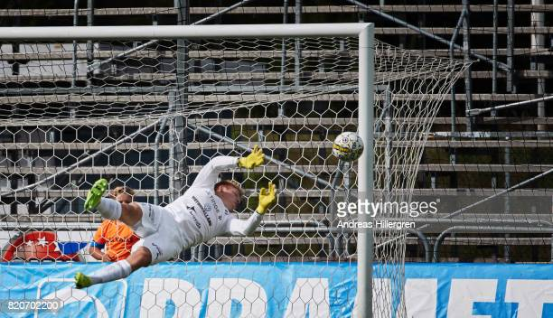 of Isak Pettersson goalkeeper of Halmstad BK makes a save during the Allsvenskan match between Halmstad BK and GIF Sundsvall at Orjans Vall on July...