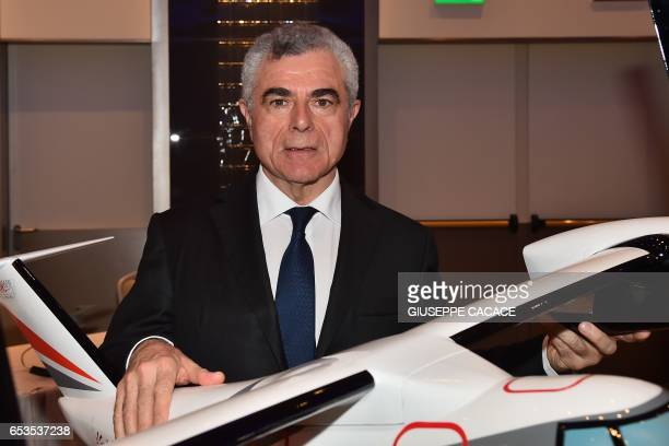 CEO of Italian multinational aerospace and defence company Leonardo Mauro Moretti poses with a model plane before a press conference in Milan on...
