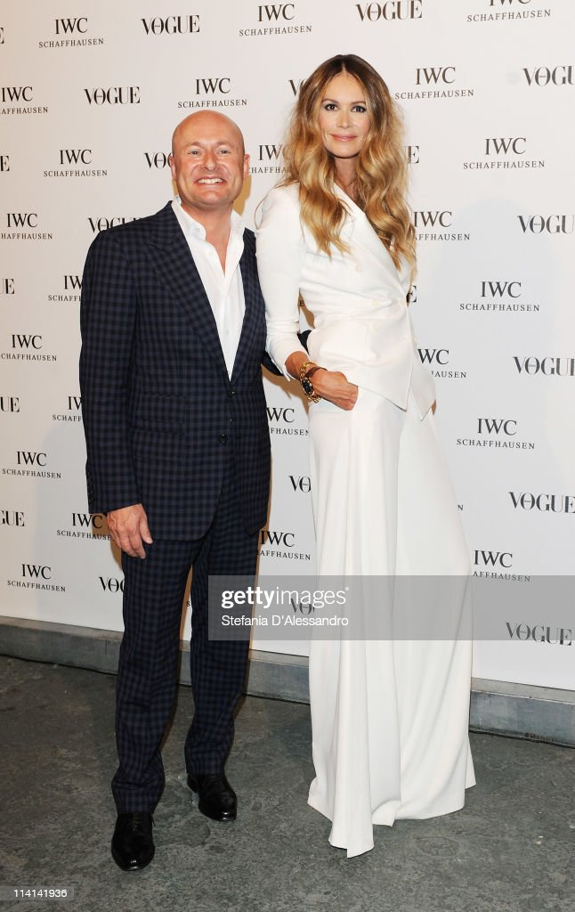 CEO of IWC Georges Kern (L) and <a gi-track='captionPersonalityLinkClicked' href=/galleries/search?phrase=Elle+Macpherson&family=editorial&specificpeople=202490 ng-click='$event.stopPropagation()'>Elle Macpherson</a> attend Vogue and IWC present 'Peter Lindbergh's Portofino' at 10 Corso Como on May 12, 2011 in Milan, Italy.