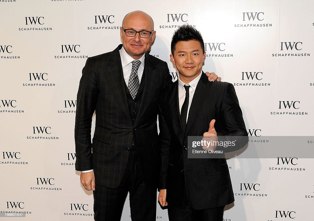 CEO of IWC Georges Kern and Olympic gold medalist Chen Yibing pose for photographs during the IWC Flagship Boutique Opening on November 22, 2012 in Beijing, China.