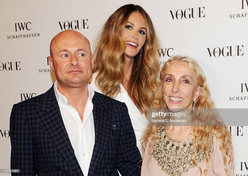 CEO of IWC Georges Kern, <a gi-track='captionPersonalityLinkClicked' href=/galleries/search?phrase=Elle+Macpherson&family=editorial&specificpeople=202490 ng-click='$event.stopPropagation()'>Elle Macpherson</a> and <a gi-track='captionPersonalityLinkClicked' href=/galleries/search?phrase=Franca+Sozzani&family=editorial&specificpeople=639425 ng-click='$event.stopPropagation()'>Franca Sozzani</a> attend Vogue and IWC present 'Peter Lindbergh's Portofino' at 10 Corso Como on May 12, 2011 in Milan, Italy.