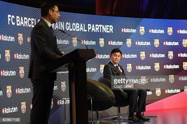 CEO of Japanese company Rakuten Hiroshi Mikitani listens to Barcelona's president Josep Maria Bartomeu after signing an agreement between FC...