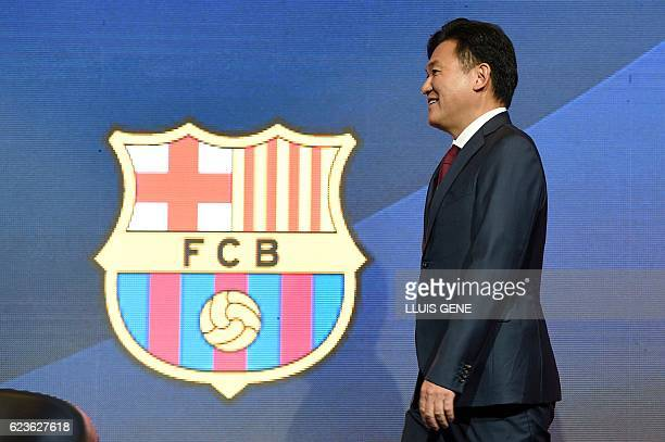 CEO of Japanese company Rakuten Hiroshi Mikitani walks past FC Barcelona's logo after signing an agreement between FC Barcelona and its new sponsor...