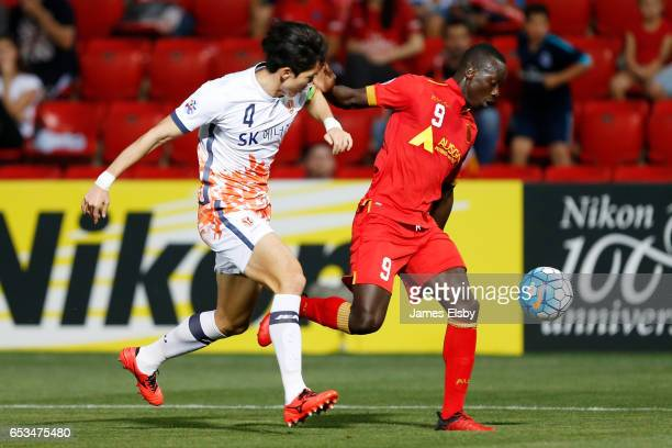 BANSUK of Jeju United tackles PAPA BABACAR DIAWARA of Adelaide United during the AFC Asian Champions League match between Adelaide United and Jeju...