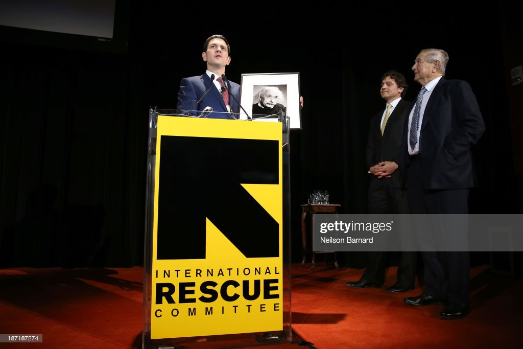CEO of JS Capital Management Jonathan Soros, IRC President and CEO <a gi-track='captionPersonalityLinkClicked' href=/galleries/search?phrase=David+Miliband&family=editorial&specificpeople=206702 ng-click='$event.stopPropagation()'>David Miliband</a>, and <a gi-track='captionPersonalityLinkClicked' href=/galleries/search?phrase=George+Soros&family=editorial&specificpeople=212841 ng-click='$event.stopPropagation()'>George Soros</a> speak onstage at the Annual Freedom Award Benefit hosted by the International Rescue Committee at the Waldorf-Astoria hotel on November 6, 2013 in New York City.